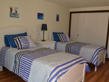 Chilmark Martha's Vineyard vacation rental - Twin beds in the first floor bedroom featuring sliding doors.