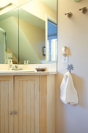 Katama - Edgartown Martha's Vineyard vacation rental - Light filled bathroom with vanity sink.