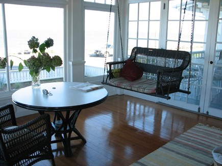 Oak Bluffs Martha's Vineyard vacation rental - Front porch w/ bench swings overlooking the beach and Ocean Park