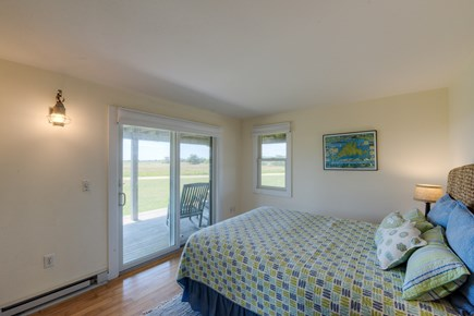 Katama - Edgartown, Katama Martha's Vineyard vacation rental - Queen size bedroom w/ slider to front mahogany deck and views