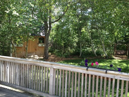 West Tisbury Martha's Vineyard vacation rental - Rear view toward the charming garden shed and the shaded glider