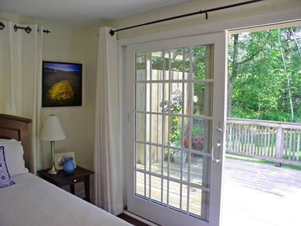 West Tisbury Martha's Vineyard vacation rental - 1st FL queen BR's sliders to the rear deck. A peek of the O/S.