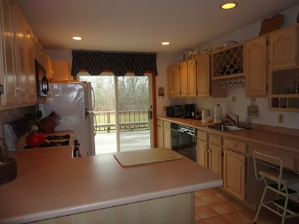 Edgartown Martha's Vineyard vacation rental - Kitchen with slider doors leading to spacious deck and large yard