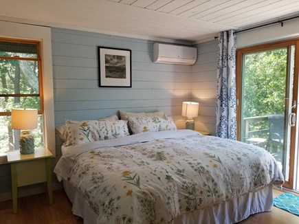 Vineyard Haven Martha's Vineyard vacation rental - Master bedroom with window (visible) and sliders to deck.