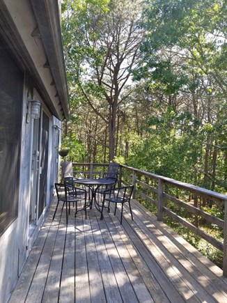 Vineyard Haven Martha's Vineyard vacation rental - Wooded view from deck, deck has table and four chairs.
