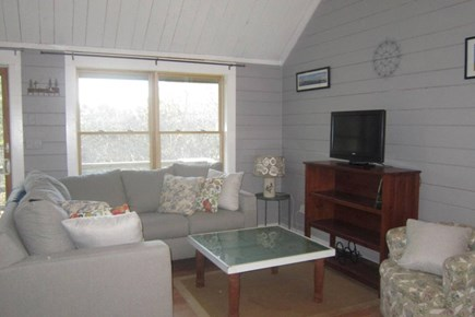 Vineyard Haven Martha's Vineyard vacation rental - Sitting area with new sectional couch and view of woods.