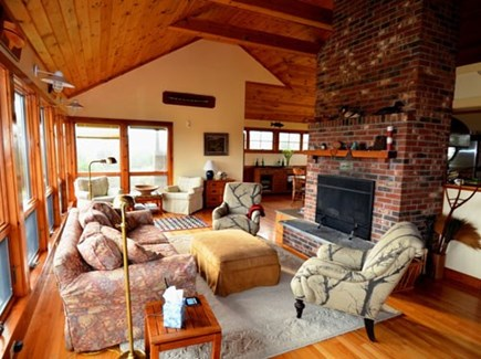Chilmark Martha's Vineyard vacation rental - Vaulted ceiling living room with brickwork fire place.
