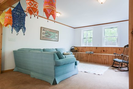 Edgartown Martha's Vineyard vacation rental - Relax on the bright blue sectional sofa as you play a board game