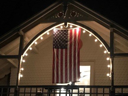 Oak Bluffs Martha's Vineyard vacation rental - Front porch in evening with decorative lights.