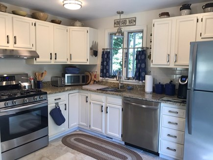 Oak Bluffs Martha's Vineyard vacation rental - Open kitchen, stainless appliances, sliding doors lead to deck.