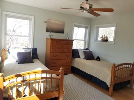 Vineyard Haven Martha's Vineyard vacation rental - Bed rm 3: 2 singles, dresser, area rug, door to balcony deck.