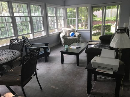 Edgartown Martha's Vineyard vacation rental - Enclosed Four Season Porch with couch and table