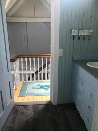 Oak Bluffs Martha's Vineyard vacation rental - New floor and vanity in upstairs bath, looking out to hall.