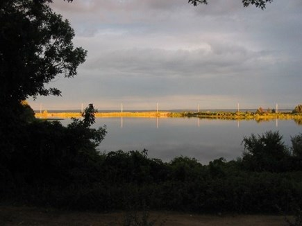 Oak Bluffs Martha's Vineyard vacation rental - Sunset colors from porch. Great paddling on Farm Pond to fishing.