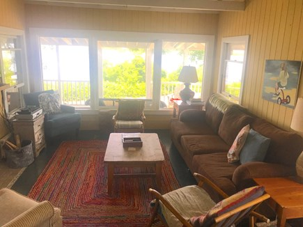 Oak Bluffs Martha's Vineyard vacation rental - Living room with wide views of pond & ocean. Wood FP, flatscreen.