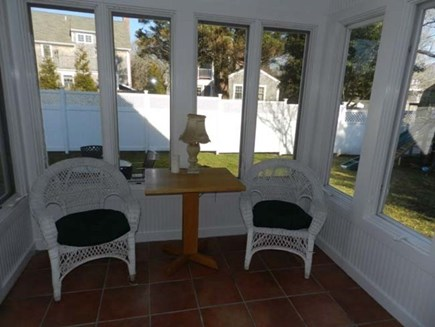 Edgartown Martha's Vineyard vacation rental - Cozy porch overlooking patio and swing set.
