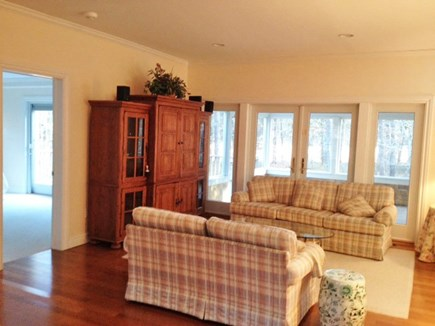 Harthaven Oak Bluffs Martha's Vineyard vacation rental - rear LR couches, king BR  left, & french doors to screened porch