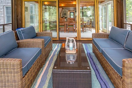 West Tisbury Martha's Vineyard vacation rental - Circular Screened Porch Looking into Dining Room - First Floor