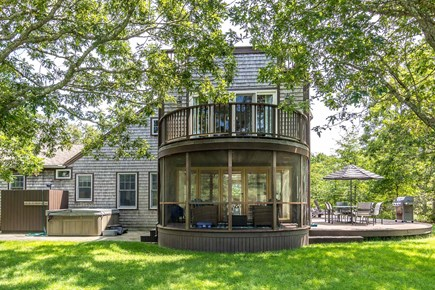 West Tisbury Martha's Vineyard vacation rental - View of Circular Screen Porch and Master Bedroom Deck