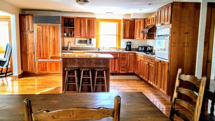 Vineyard Haven Martha's Vineyard vacation rental - Open kitchen, high-end appliances, with island and dining table.