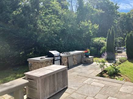 Oak Bluffs Martha's Vineyard vacation rental - The backyard oasis contains a grille, sink, shower, patio & more