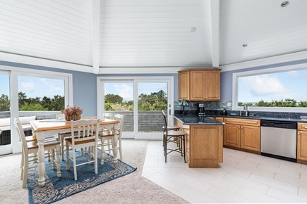 Chappaquiddick, Wasque Point Martha's Vineyard vacation rental - Dining area and kitchen, west-facing with spectacular sunset view