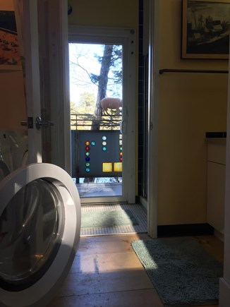Oak Bluffs Martha's Vineyard vacation rental - Washer/dryer (on 1st floor) with vanity and toilet/shower beyond