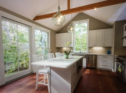Katama - Edgartown Martha's Vineyard vacation rental - Spacious kitchen area with sliders out to yard, door to deck.