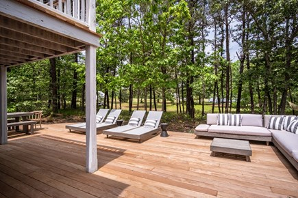 Oak Bluffs, Waterview Farms Martha's Vineyard vacation rental - Expansive mahogany deck with meadow view through the pines