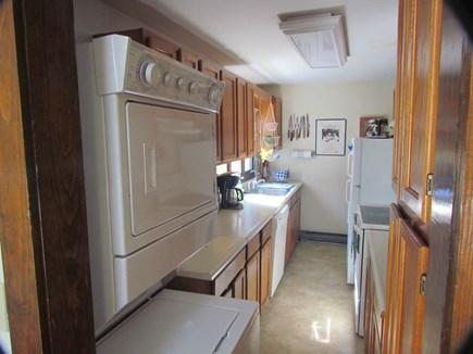 oak bluffs Martha's Vineyard vacation rental - Galley Kitchen: Washer/dryer, dishwasher, electric stove, fridge.