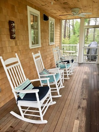 Oak Bluffs Martha's Vineyard vacation rental - Screened porch with 4 rockers and two ceiling fans. Wooded view.