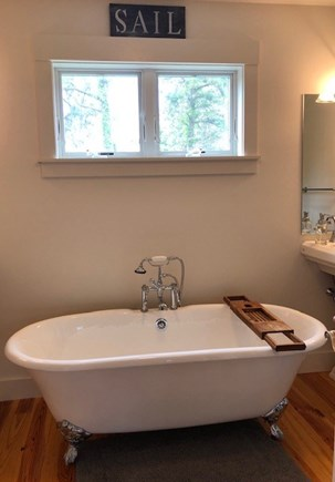 Oak Bluffs Martha's Vineyard vacation rental - Master bathroom. Cast Iron tub, double sinks, walk in shower.
