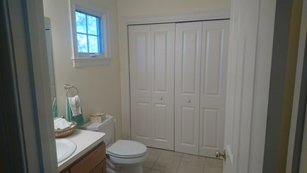 Edgartown, Walking distance to downtown  Martha's Vineyard vacation rental - Half bath with laundry area behind folding doors.