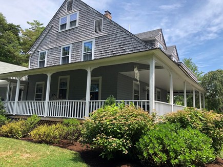 Vineyard Haven Martha's Vineyard vacation rental - Side view of wrap around porch that faces large grassy yard.