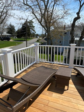 Oak Bluffs, East Chop Martha's Vineyard vacation rental - Upper renovated deck with lounge chairs and slight waterview