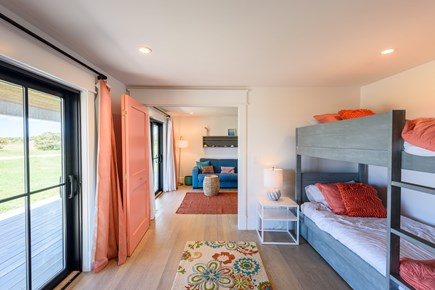 Katama - Edgartown Martha's Vineyard vacation rental - Kids bunk room looking into TV/playroom. Sliders out to deck.