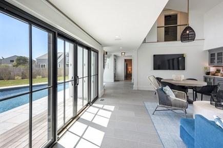 Katama - Edgartown Martha's Vineyard vacation rental - Family room with view of pool outside.