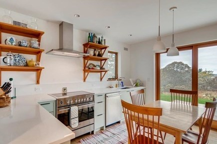 Chilmark Martha's Vineyard vacation rental - Kitchen with sliding doors to deck with water views and gas grill