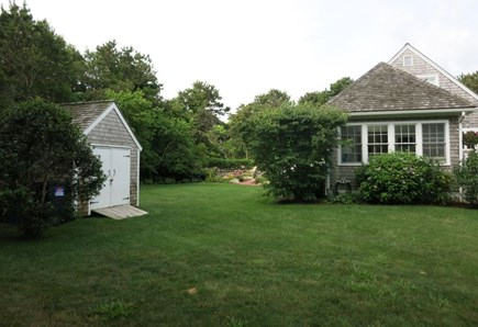 Edgartown Martha's Vineyard vacation rental - Shed, sunroom and front yard with driveway in distance.