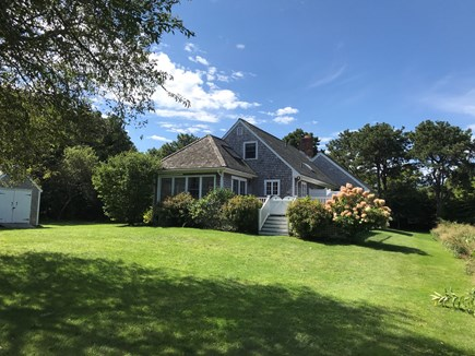 Edgartown Martha's Vineyard vacation rental - Meadow like side and backyard showing shed and large deck in back
