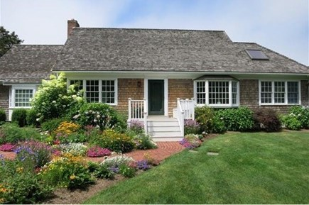 Edgartown Martha's Vineyard vacation rental - Front view of sunny home with brick path and perennial gardens.