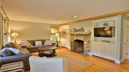 Oak Bluffs Martha's Vineyard vacation rental - Living room with 40-inch Samsung SmartTV and beach stone fireplac