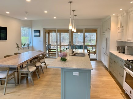 Edgartown, Ocean Heights Martha's Vineyard vacation rental - Well-appointed kitchen flows to spacious screened-in porch.