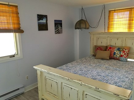 Chappaquiddick Martha's Vineyard vacation rental - Bedroom with queen bed, two windows, a dresser and a closet.