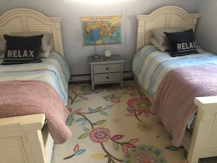 Chappaquiddick Martha's Vineyard vacation rental - Two twin beds with one trundle each. Dresser and two windows.