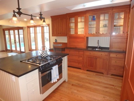 West Tisbury Martha's Vineyard vacation rental - Sun filled kitchen with a view to the pool area.