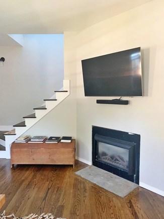 Oak Bluffs Martha's Vineyard vacation rental - Flatscreen over fireplace in living room (stair rail installed)