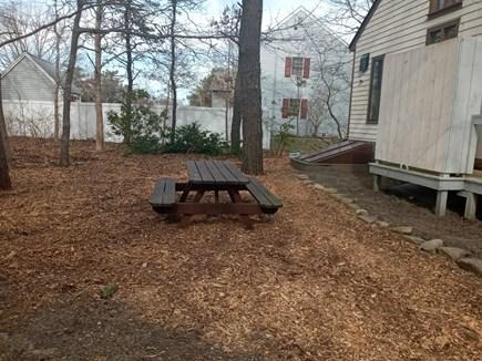 Katama - Edgartown, Edgartown Estates Martha's Vineyard vacation rental - Picnic table.  When you are here so too lilies/daisies