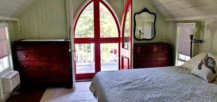 Oak Bluffs Martha's Vineyard vacation rental - Master bedroom with new queen bed, balcony, and window AC