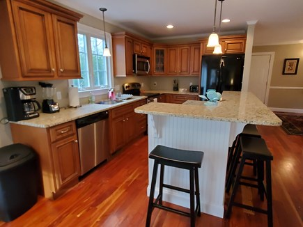 Oak Bluffs, 02557 Martha's Vineyard vacation rental - Fabulous kitchen with seating at counter plus eat-in table area.